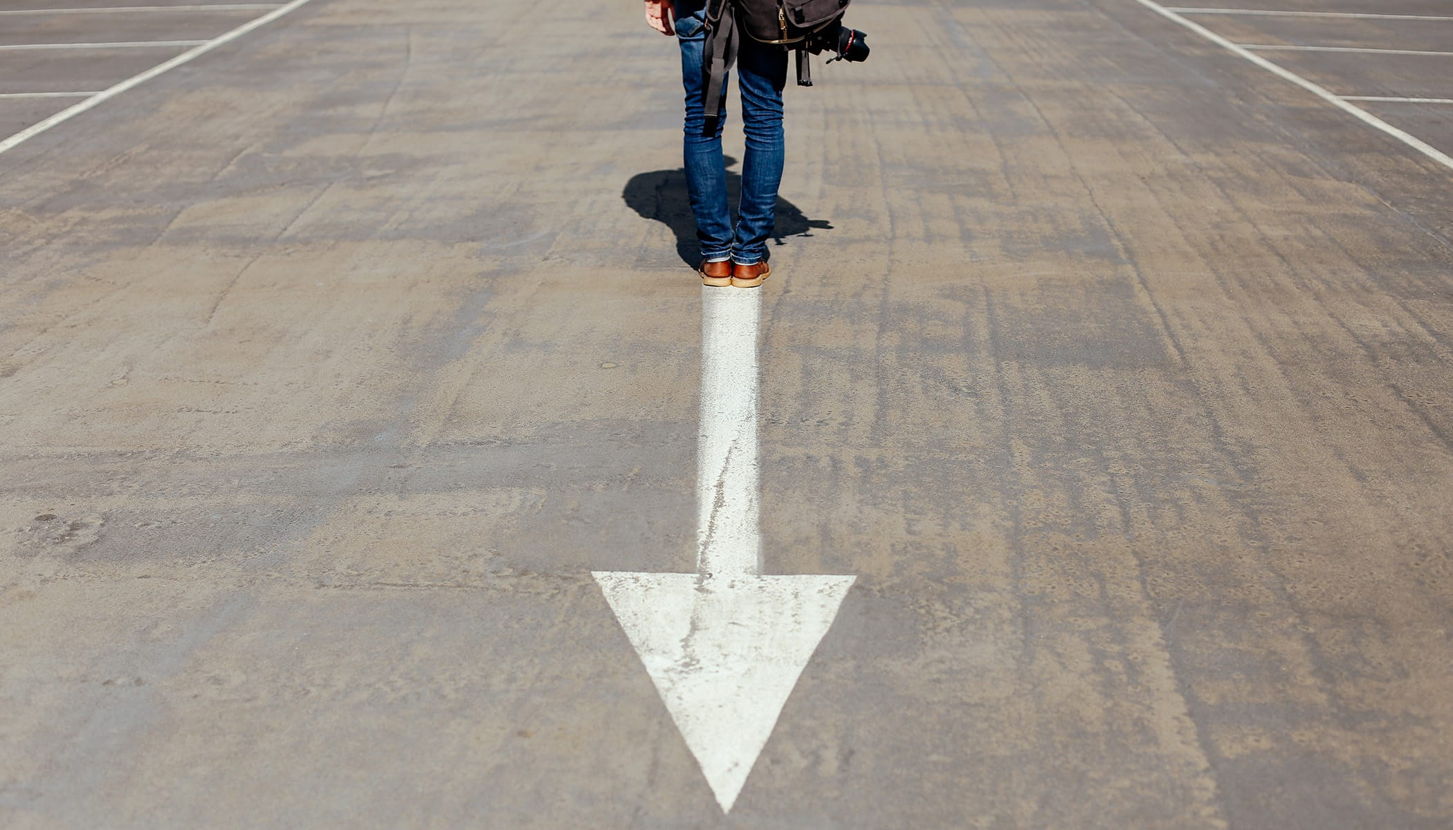 Person with camera standing on a parking lot